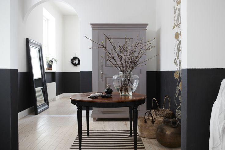 I love the vertical stencil over the painted half-wall!