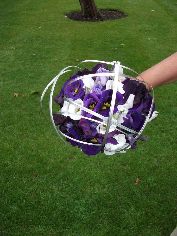 Purple lisianthus, calla lily and silver beargrass bouquet
