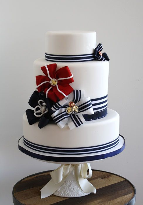 I like the multiple bows in one place, not just one bow here, another there...Bobbette & Belle   Signature Wedding Cakes