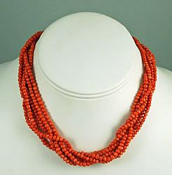 This is an exquisite Victorian Era Multi-strand Red Coral Necklace. The coral is all natural Sardinian red coral that was all hand cut. The six strands of 3-4mm beads are strung on red silk. The beads on the first and last inch are all hand knotted, which makes the necklace stronger and prevents bead loss if there ever is a break. It is a sign of excellent quality. There is a 14Kt gold fluted tube clasp and filigree bead caps.