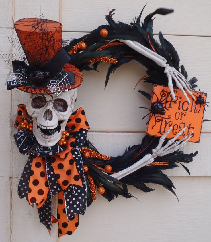 Halloween Skeleton Wreath, Skeleton wreath, trick or treat wreath, Halloween wreath, spider wreath, skull wreath, orange and black wreath by DesignsbySheilaB on Etsy https://www.etsy.com/listing/250183045/halloween-skeleton-wreath-skeleton