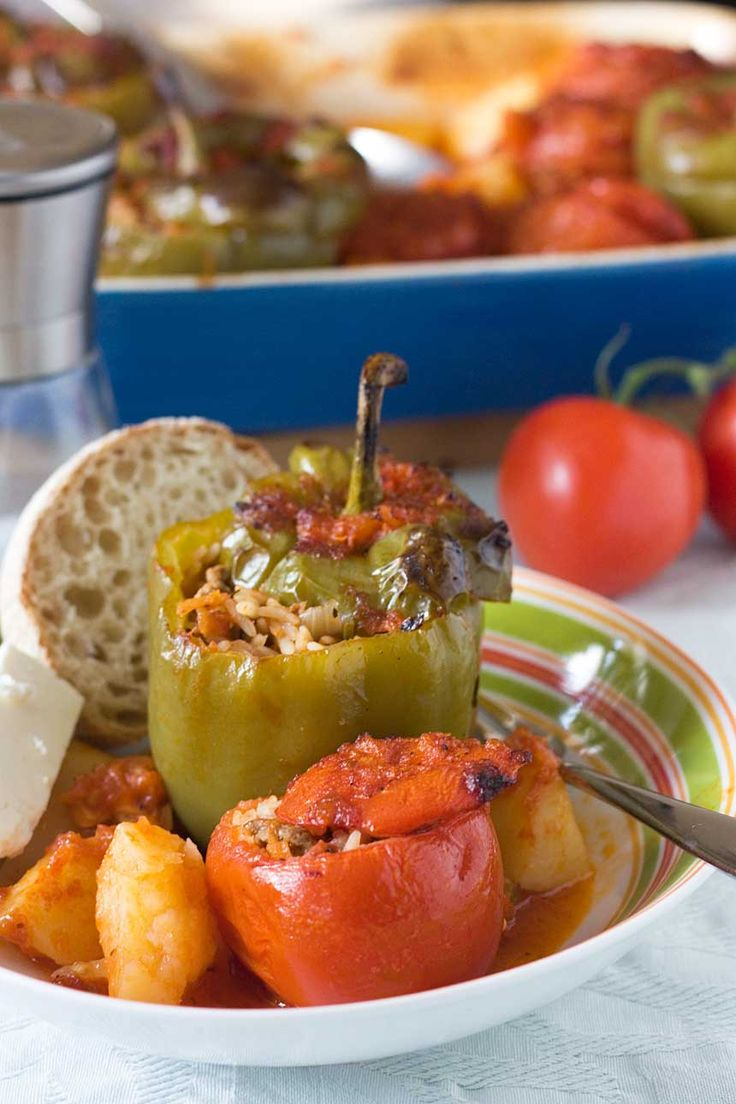 A classic Greek dish. Every household has their own way of making these stuffed peppers and tomatoes. Cover in tomato sauce and serve with feta cheese. Mmm!