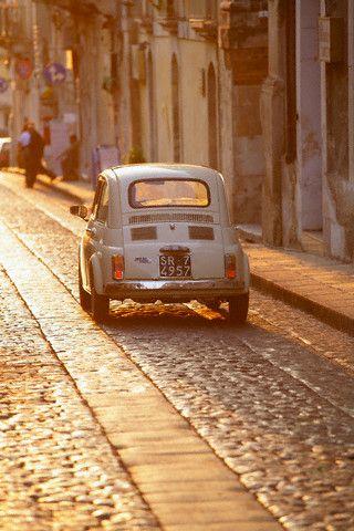 Fiat 500 Driving Down Cobblestone Street (Photo via In Classic Style)