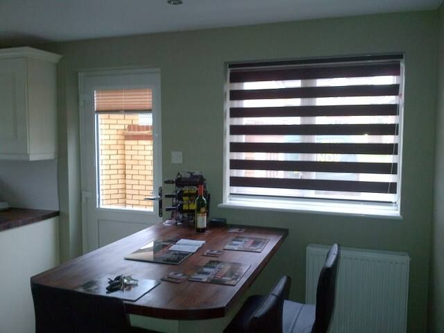 Perfect fit pleated blind on the door and vision blind on the window.