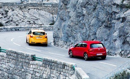 2015 #Volkswagen #GTI vs. 2013 #Ford #Focus #ST  Hatching a Revolt. Here's a radical idea: These zealous hatchbacks are all the car you'll need.