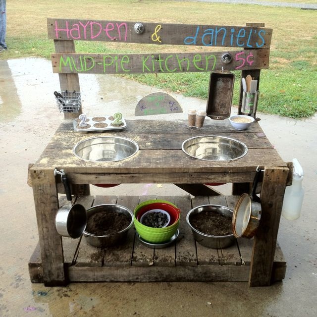 Mud pie kitchen. I think this might be the design I go with made out of what looks like old pallets and metal bowls.
