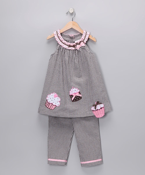 Take a plunge into this treat. Embroidered cupcakes, playful polka dots and bright bows look even lovelier thanks to this set's lightweight seersucker fabric, which will have cuties feeling as sweet as they look.Includes tunic and leggings55% cotton / 45% polyesterMachine wash; tumble dry