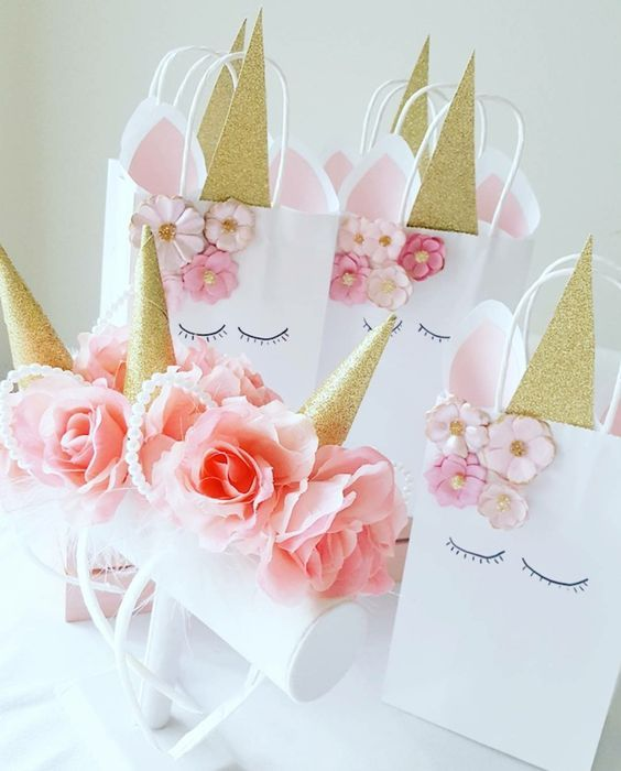 Unicorn horn headbands and gift bags from a Sweet Unicorn Birthday Party on Kara's Party Ideas | KarasPartyIdeas.com (13)