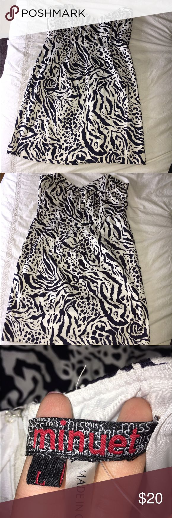 Animal Print Formal Dress Comfortable navy and white animal print formal dress. This was purchased from the website LuLu's and had very minor alterations done to it, but still didn't fit me right so it has never been worn except for me to try on. Tag has been removed. I am 5'2 and it hits a little below mid-thigh. There are 2 metal bars in the bust area to help hole the structure in the chest area Minuet Dresses Strapless