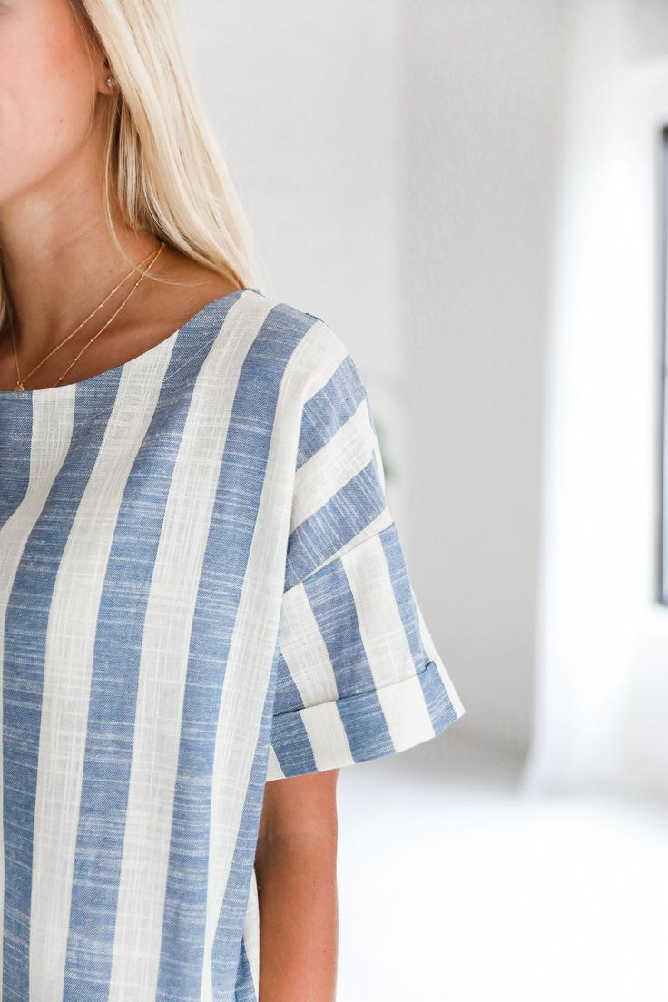 • Ivory and blue short sleeve round neck multi-directional striped dress • Available in sizes S, M, L. Model is wearing a size small • 100% Cotton