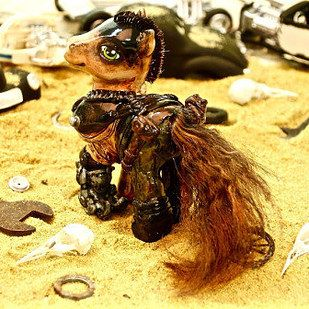 """""""I made them over old My Little Pony toys with polymer clay, epoxy, acrylics, faux fur [and] leather,"""" Wailes told BuzzFeed. """"I dyed their hair and made sure their moving parts still worked and fit into the sculptures."""" 