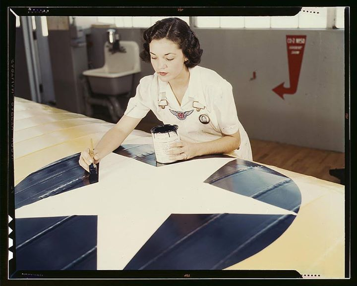 Painting the American insignia on airplane wings is a job that Mrs. Irma Lee McElroy a former office worker does with precision and patriotic zeal. Mrs. McElroy is a civil service employee at the naval Air Base Corpus Christi Texas. Her husband is a flight instructor (1942 August)