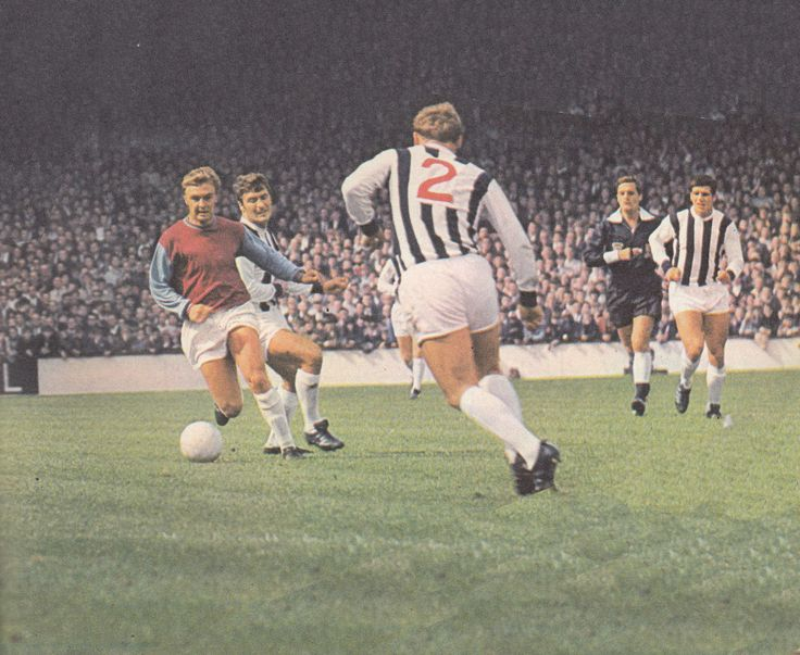 31st August 1968. West Ham United wide man John Sissons skipping past West Brom's Ian Collard.