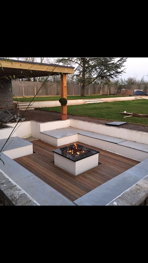 Sunken seating area with fire pit:
