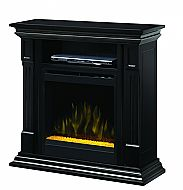 """36"""" Dimplex Deerhurts Black Glass Entertainment Center Fireplace. his striking, black finished fireplace converts in seconds to a corner configuration which is ideal for supporting a 42"""" TV. Featuring fluted pilasters and carved detailing, this package is complete with its surround and picture frame firebox molding."""