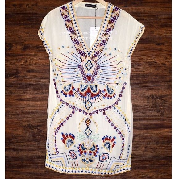 FREE PEOPLE Dress Embellished Beaded Ella Shift Size Euro 38, US Small. New with tags.  $550 Retail + Tax.   Gorgeous sheer shift dress with beading and embroidery throughout.  Hidden side zip closure. Semi-sheer lining.  By Antik Batik for Free People.   Viscose.  Imported.  Echoing Ella.   ❗️ No trades, holds or modeling.    Bundle 2+ items for a 20% discount!    Stop by my closet for even more items from this brand!  ✔️ Items are priced to sell, however reasonable offers will be…