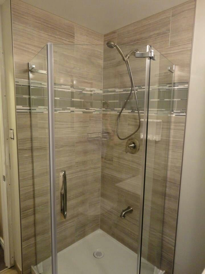 Completed corner shower. Porcelaine 12 x 24 tiles, glass 3 x 12 and mix mosaic.