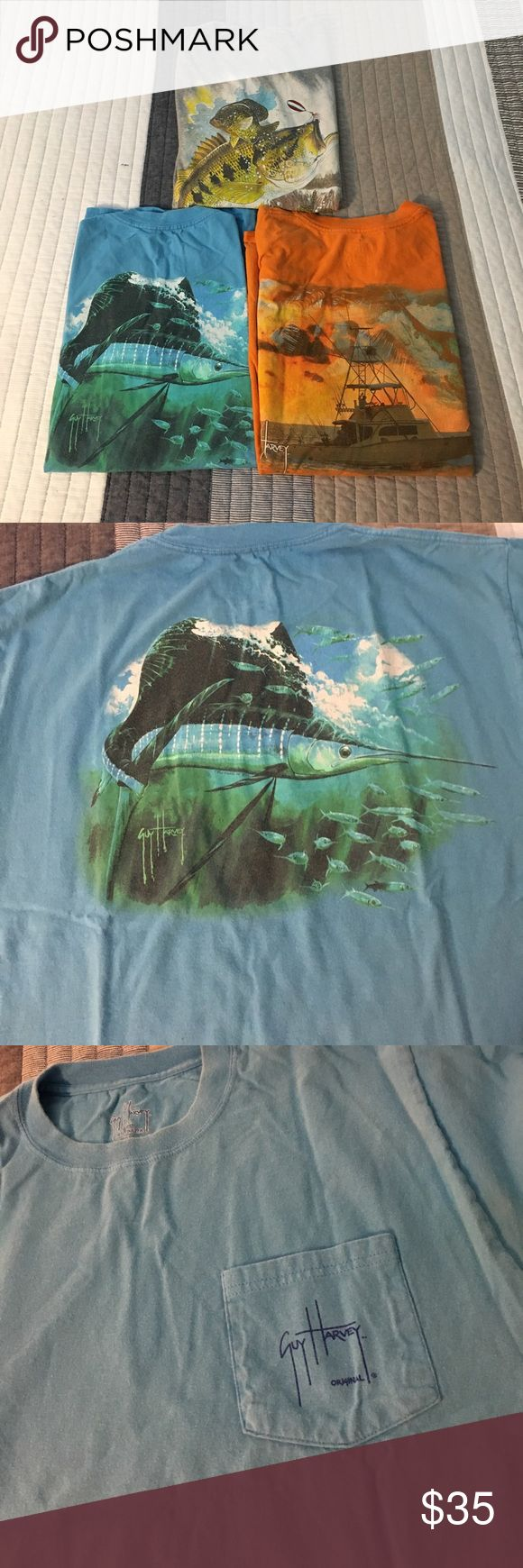 3 Guy Harvey fishing t-shirts Two pocket t-shorts, orange and blue. One t-shirt without a pocket, grey. All in great condition. Graphics on the back of each shirt with the Guy Harvey signature on the front of the shirt. Guy Harvey Shirts Tees - Short Sleeve