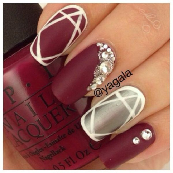 White and maroon nail art design in matte colors. Matte colors are beautiful when it comes to having that majestic finish, coupled with a silver matte polish and embellishment, the design looks perfect.