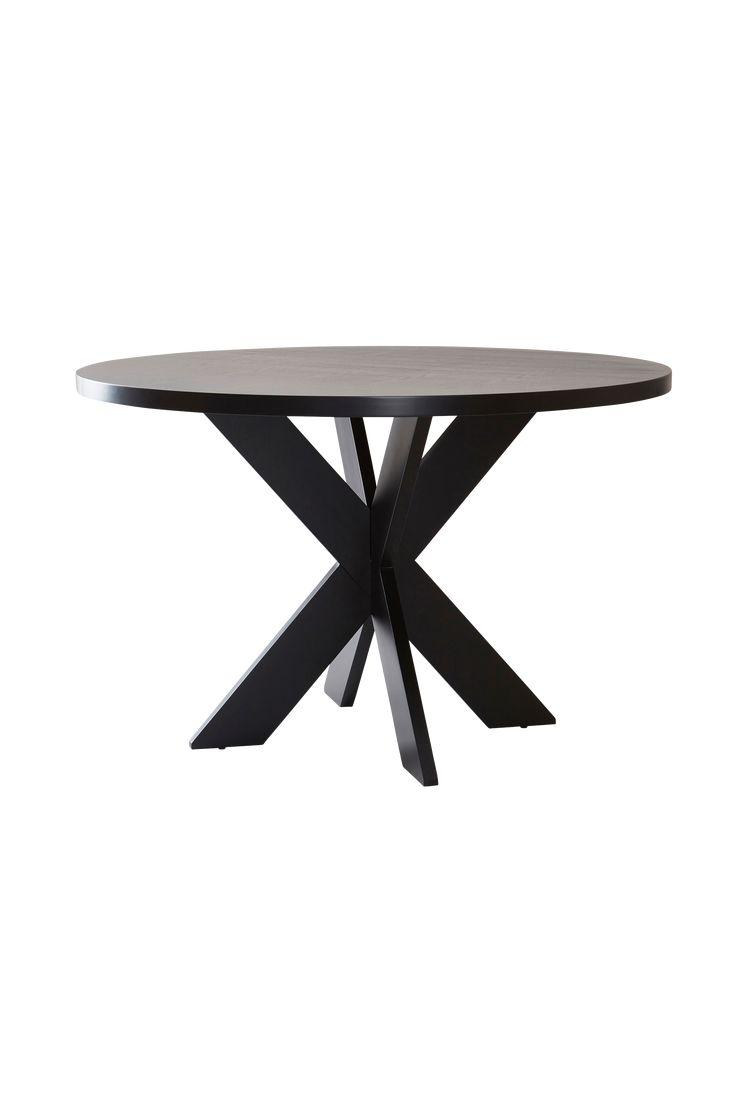 Elegant runt bord med askfaner och kryss-underrede.  Material: MDF. Storlek: Höjd 76 cm, ø 120 cm. Beskrivning. Runt bord av mdf med askfaner. Viss montering krävs. Tips/råd: För mer kontrast - blanda mörkt matbord och ljusa stolar eller tvärt om.