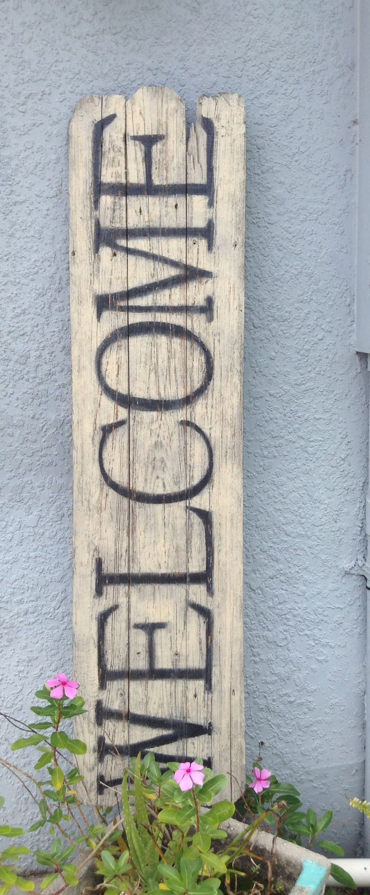Artist Cynthia Amaral, welcome sign using old fence boards
