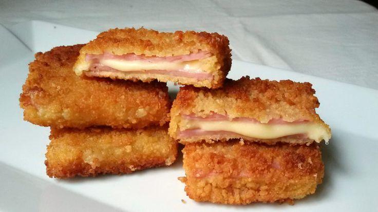 San Jacobos caseros muy fáciles  Ingredientes Para 8 unidades  4 lonchas de jamón york gruesas o 8 finas 6 lonchas de queso tierno 1 huevo 2 cucharadas de harina Pan rallado grueso Aceite de girasol