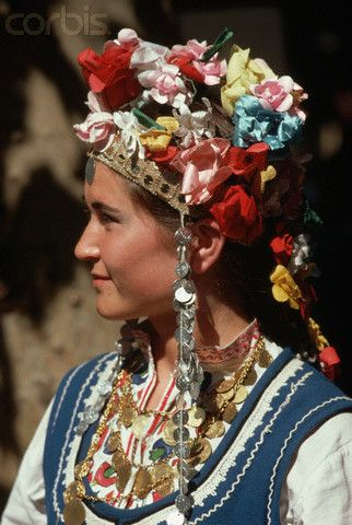 Bulgaria | A woman wears traditional dress including a headdress in Talboukhin |  © Charles & Josette Lenars