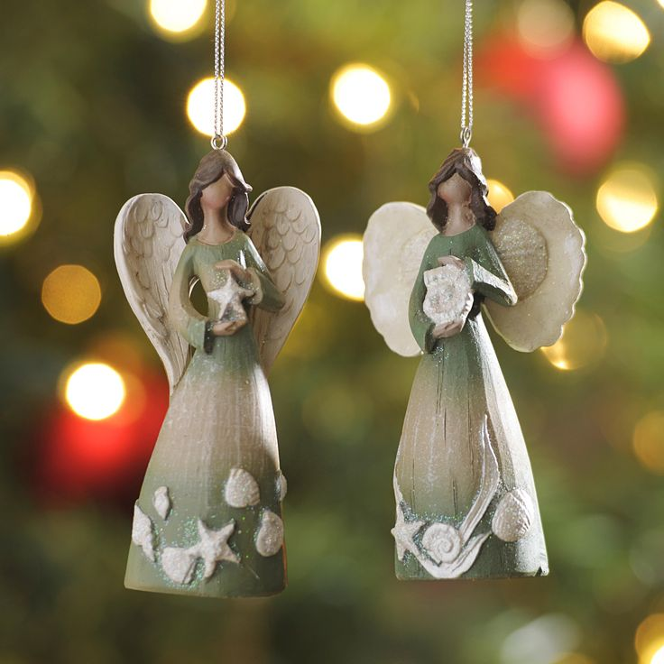 Whether you live by the sea or just love the beach, this set of Coastal Angel Ornaments is perfect for your tree. With a coastal Christmas touch, these angels are holding a starfish and a shell and feature teal dresses with glitter accents.