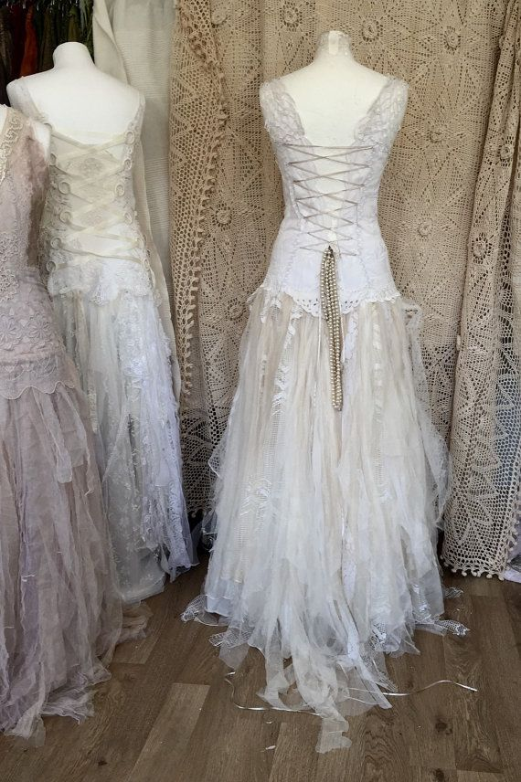 a very special tattered wedding dress a handmade lace wedding dress . A one of a kind piece , a complete unique boho bridal gown. Every bride will