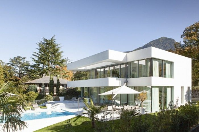 Pool and Lounge View Modern White House Design By Monovolume Architecture + Design