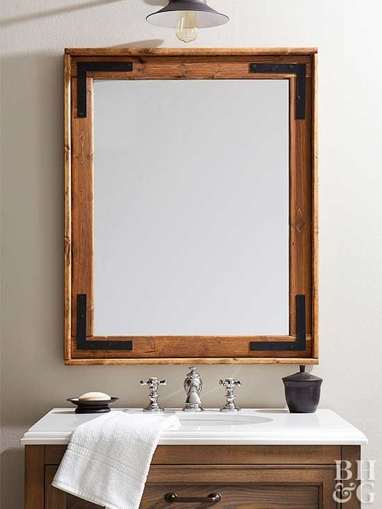 A new mirror is a quick and easy way to upgrade the style of your bathroom. To get all the benefits of a statement mirror without leaving a dent in your wallet, consider making your own mirror frame. Here, we show you how to build a farmhouse-style mirror frame complete with industrial hardware and stained wood. #farmhousestyle #diy #homedecor #mirror