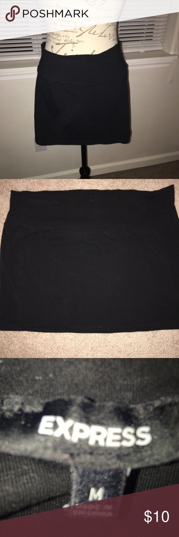 Express Micro Mini Skirt Size Medium Black micro mini skirt from Express in great used condition. This skirt is perfect to wear over leggings. Hot look with knee high or over knee boots. Express Skirts Mini