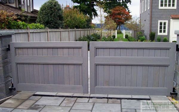 Wood double swing gate with a custom paint color to compliment the exterior on the house #custom #gate #entrance #driveway #security #privacy #automatic #electric