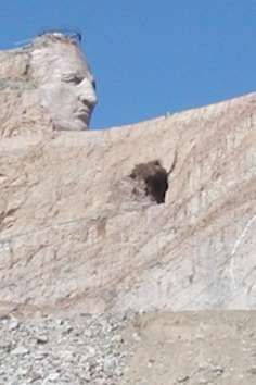 Sure, Mount Rushmore is impressive, but a mere 15 miles away, an even more impressive monument is in the works...and has been for 66 years. When completed, it's slated to be the world's biggest sculpture; but it's far from being finished. When the statue, which depicts Oglala Lakota warrior Crazy Horse, is done, it'll stand 563 feet tall and 641 feet wide. His head alone is 87 feet-- for comparison, the faces of the presidents on Mount Rushmore are only 60 feet.  But what'...