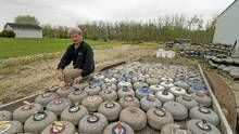 Al Thompson with a trailer full of old curling rocks at his facility a few kilometers east of Winnipeg Thursday May 19, 2011. Thompson finds old curling rocks from rural prairie towns and resells them, mainly to the US where the sport is taking off. (David Lipnowski for The Globe and Mail/David Lipnowski for The Globe and Mail)