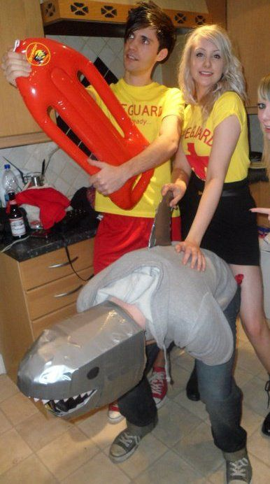Beach party/ baywatch fancy dress - everyone goes as life guards.... Dickie cracks out the shark!