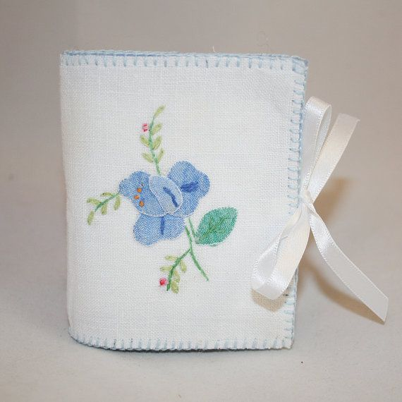 A pretty needle book, sympathetically created from an embroidered appliqueed tray cloth, combined with coordinating blanket stitch edging and
