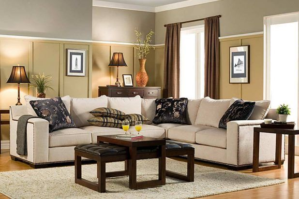 Natural sectional sofa with white fabric covering l shaped sectional comfortable sofa and dark brown wooden varnish finished end table also brown shag rug area