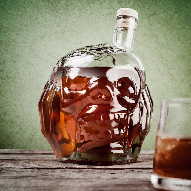 Bring on that perfect spooky groove this Halloween by storing your liquor (preferably red ones!) in this deadly Zombie Head Decanter.