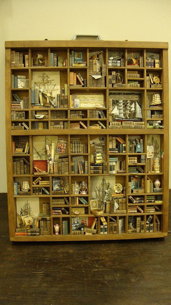"""absolutely incredible miniature library """"nautical science"""" theme displayed in a typesetters drawer"""