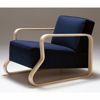 The armrest and frame of this chair are connected, creating a unique design aesthetic. Artek Alvar Aalto 44 - Lounge Chair
