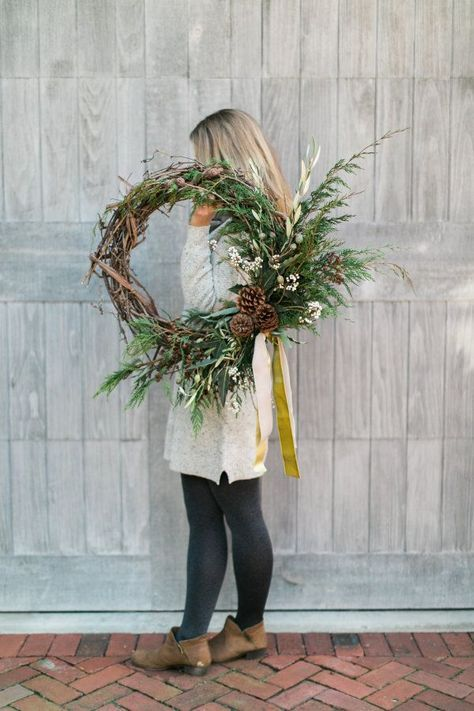 DIY holiday wreath project: http://www.stylemepretty.com/living/2016/12/21/up-your-cold-weather-curb-appeal-with-this-diy-winter-wreath/ Photography: Cadence Kennedy - http://www.cadencekennedy.com/