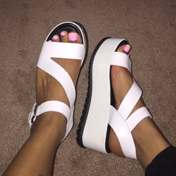 Flatform sandals White flatform sandals from ASOS! Super cute, a few scuffs as seen in pic but still in GREAT condition. ASOS Shoes Platforms