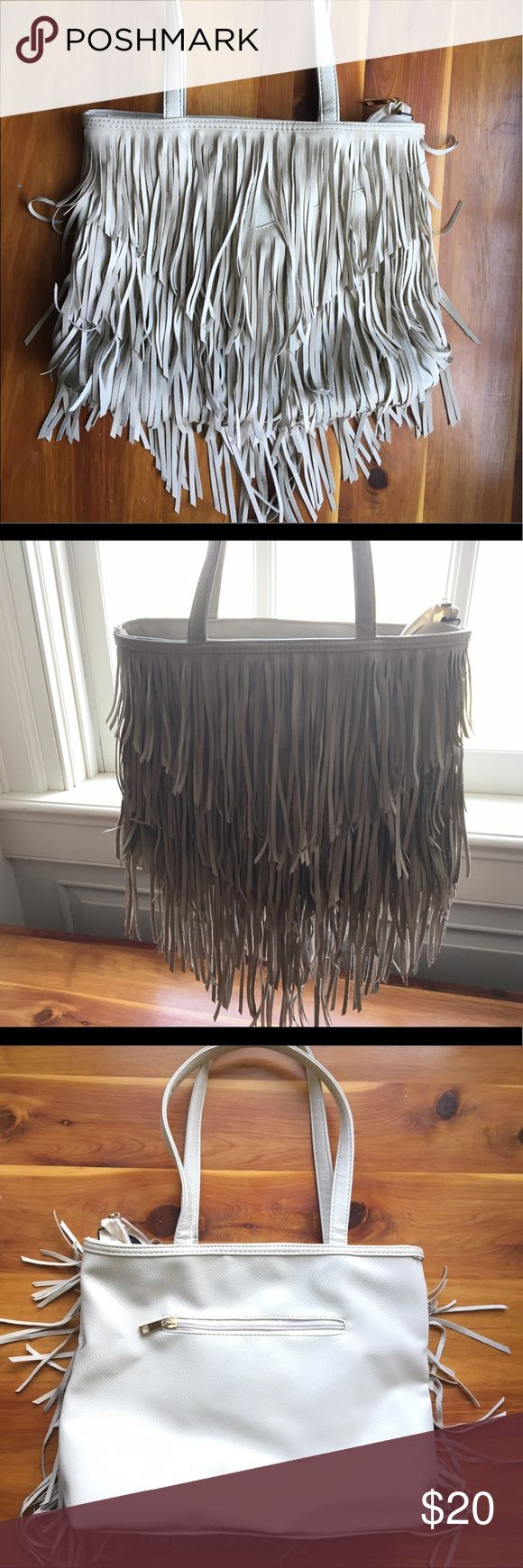 Off-white fringe bohemian handbag UrbanOG This is a never before used handbag. It has a very slightly off white color, fringe all over the front, a zipper on the back, and a black fabric interior. 🌙 UrbanOG Bags Shoulder Bags
