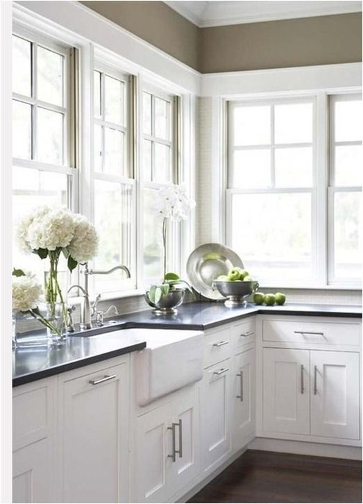 Sweet Kitchen Design With Khaki Walls Paint Color, Farmhouse Sink And White  Shaker Kitchen Cabinets With Honed Black Granite Counter Top. Part 34