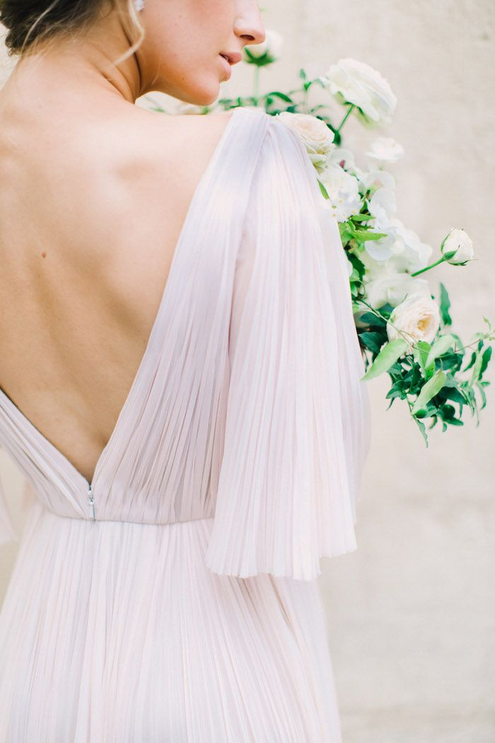 how beautiful is the draping on this pale blush wedding gown?