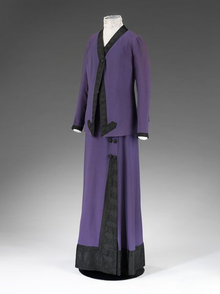 Coat | Mascotte | VA Search the Collections London, England (made)  Date: ca. 1912 (made)  Artist/Maker: Mascotte (maker)  Materials and Techniques: Wool gabardine, lined with silk satin, trimmed with Jacquard-woven silk,