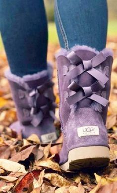 Pretty purple bow UGG boots for girls.