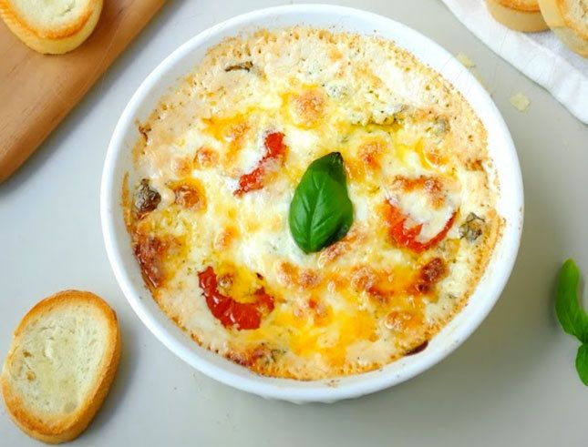 Caprese Pizza Dip cream cheese, mozzarella, basil, tomatoes, parmesan, garlic, oregano