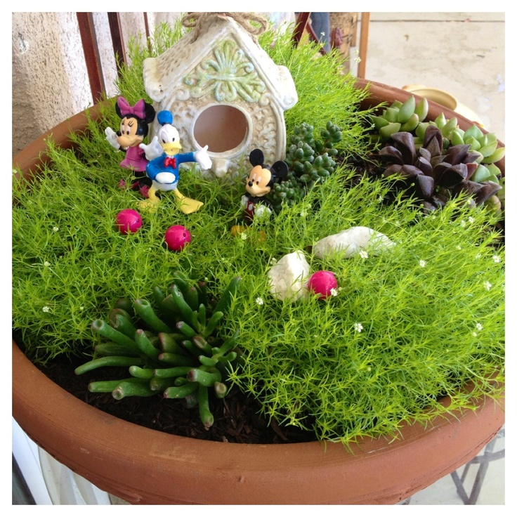 I cant find a fairy to decorate my lil girls fairy garden, so instead used mickey mouse, donald and minnie!!! She loves it! Her mini-disneyland